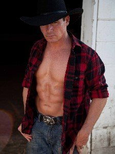 Nashville Male Stripper Jesse Dressed as Cowboy with Shirt Open Showing Defined Abs
