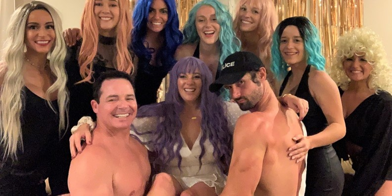 Nashville Male Strippers Jesse and RC with bachelorettes who are wearing colorful wigs